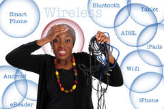 Wireless. Frustrated african woman standing with wires in her hand.  Wireless solutions in the background Stock Photo