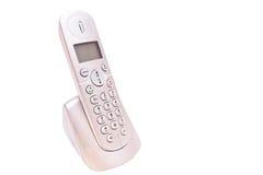 Wireless Handset Phone. Wireless Telephone for landline phone on its docking station royalty free stock image