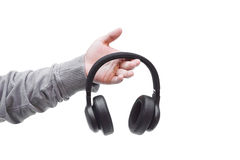 Wireless headphone. Hand holding a wireless headphone isolated Stock Photography