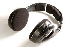Wireless headphones. Black Wireless headphones on white ground Royalty Free Stock Images