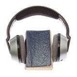 Wireless headphones and a book. Stock Photos