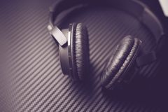 Wireless Headphones Closeup. Wireless Headphones on the Carbon Background Closeup. Music Listening Concept Royalty Free Stock Photo