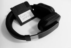 Wireless headphones and a retro floppy disk with music files royalty free stock photography