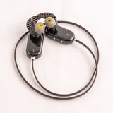 Wireless headphones rolled up Stock Photo