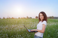 Wireless internet. Smiling woman with laptop Royalty Free Stock Images