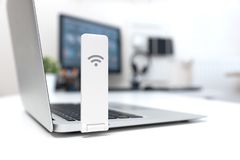 Wireless internet concept. Mobile network. Expander or mobile internet modem USB stick royalty free stock photos