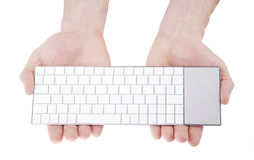 Wireless keyboard in hands. Isolated on white Stock Image