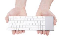 Wireless keyboard in hands Stock Image