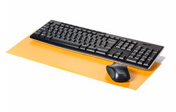 Wireless keyboard and mouse. On a yellow background Royalty Free Stock Images