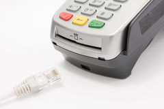 Wireless LAN cable with A credit card swipe machine on white.  Stock Photo