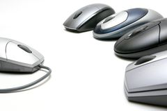 Wireless mice. Four , revolution against the old and outdated corded models. highkey shot over white, focus on left mouse Stock Images