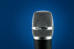 Wireless microphone on blue background Royalty Free Stock Photos