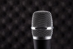 Wireless microphone closeup on foam acoustic background Royalty Free Stock Photo