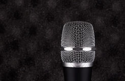 Wireless microphone closeup on foam acoustic background Royalty Free Stock Images