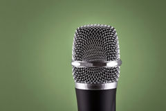 Wireless microphone on green background Royalty Free Stock Images