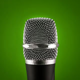 Wireless microphone on green background Stock Photos