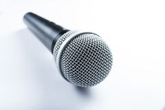 A wireless microphone lying on a white background, isolated stock image