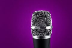 Wireless microphone on purple background Stock Image