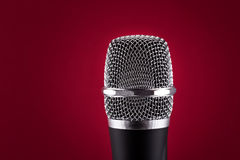 Wireless microphone on red background Stock Photo