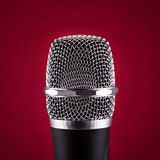 Wireless microphone on red background Royalty Free Stock Photography