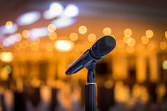 Wireless microphone stand on the stage venue. With blur bokeh background Royalty Free Stock Image