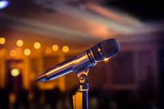 Wireless microphone stand on the stage venue. With blur bokeh background Stock Photo