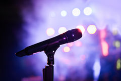 Wireless microphone stand on the stage venue. With blur bokeh background Royalty Free Stock Photography