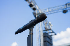 Wireless microphone stand on the venue. Wireless microphone stand on the outdoor venue Stock Photo