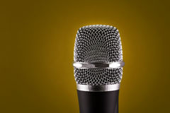 Wireless microphone on yellow background Royalty Free Stock Photos
