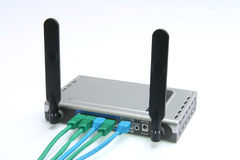 Wireless modem & router 2. Wireless modem and router with four cables Royalty Free Stock Photography
