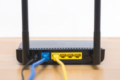 Wireless modem router with cable connecting.  Royalty Free Stock Images