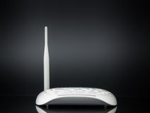 Wireless modem router network hub. On black background Royalty Free Stock Photo