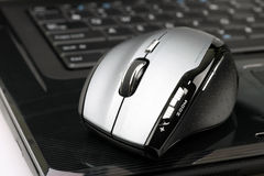Wireless mouse. On a laptop Royalty Free Stock Photos
