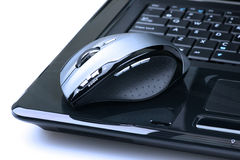Wireless mouse. On a laptop with blue filter Stock Photos