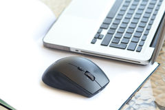 Wireless mouse. Is located near the laptop. Close up Royalty Free Stock Photography