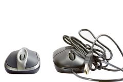 Wireless mouse and cable mouse. Royalty Free Stock Photo
