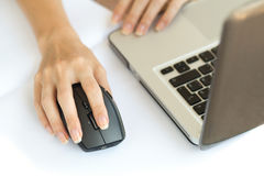 Wireless mouse with hand. Wireless mouse and the middle finger rests on the right mouse button Stock Image