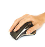 Wireless mouse with hand. Wireless mouse and the middle finger rests on the right mouse button Royalty Free Stock Photos