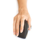 Wireless mouse with hand. Wireless mouse and the middle finger rests on the right mouse button Royalty Free Stock Photography