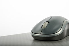 Wireless computer mouse on a metallic background Royalty Free Stock Image