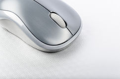 Wireless computer mouse on a metallic background Royalty Free Stock Images
