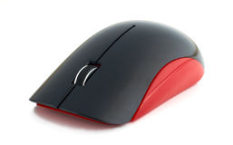 Wireless mouse on a white background. Red wireless mouse on a white background Royalty Free Stock Image