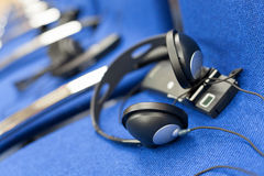 Wireless multi language headphones set Royalty Free Stock Photo