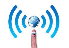 Wireless network symbol with earth on finger Royalty Free Stock Photo
