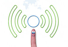 Wireless network green symbol with cercle on finger Stock Photo