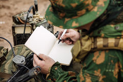 Wireless operator taking notes Stock Image