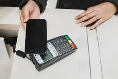Wireless Paying by mobile phone Stock Image