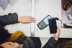 Wireless Paying by mobile phone Royalty Free Stock Images