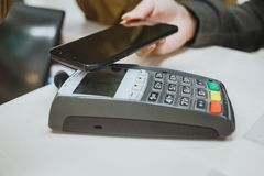 Wireless Paying by mobile phone Stock Images