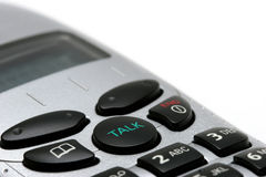 Wireless phone macro on white. Macro of a wireless phone handset over white, focus on talk button stock photography
